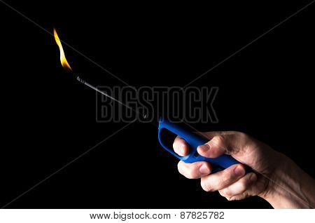 Burning Gas Lighter In A Man's Hand