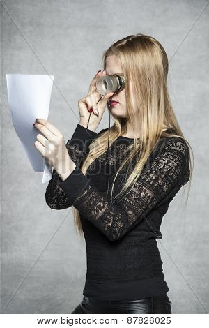 Business Woman Reading A Contract With The Magnifying Glass