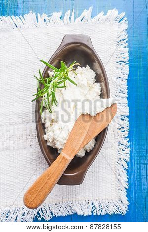 Goat Cheese With Rosemary In A Stoneware Bowl