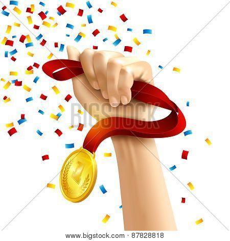 Hand holding winners medal award