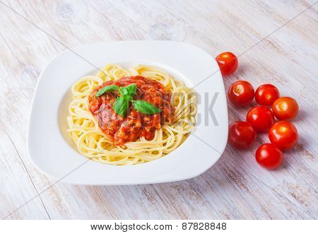 Spaghetti Bolognese In White Bowl On Wooden Table