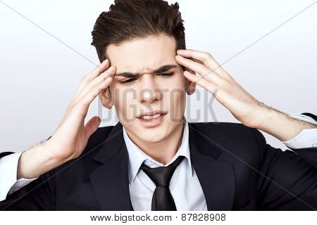 Man feeling hwadache