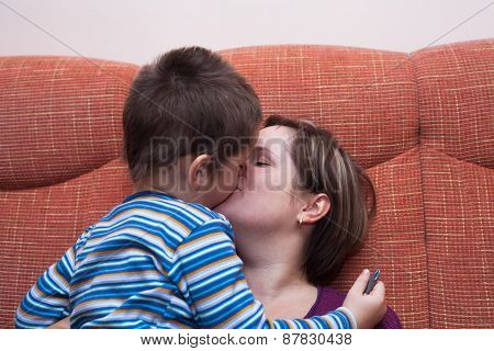Mother Kissing Her Child Boy