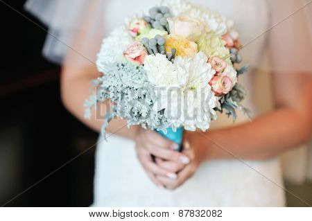 Wedding Bouquet Of White Roses In Bride's Hands