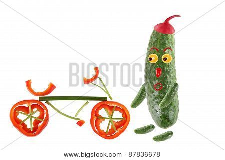 Little Funny Cucumber Standing With Bicycle. The Picture Is Made From Fruit And Vegetables