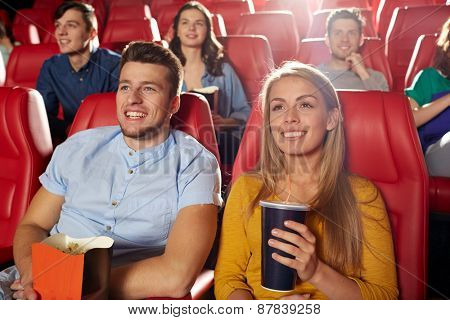 cinema, entertainment and people concept - happy friends watching movie in theater