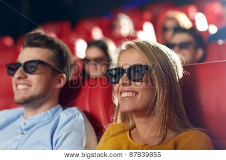 cinema, entertainment and people concept - happy friends with 3d glasses watching movie in theater