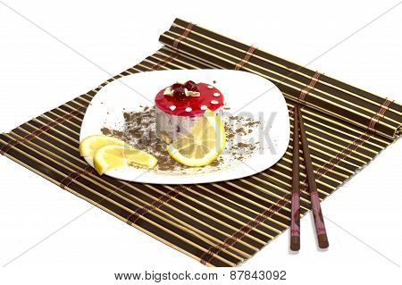 Cake White, With Lemon Segments, With Grated Chocolate, On A Rug, The Top View