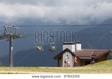 SOCHI, RUSSIA â?? JULY 23, 2015: Tourists on the ski lift, mountain resort
