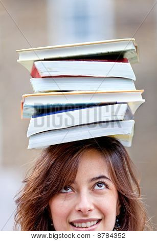 Woman Balancing Books