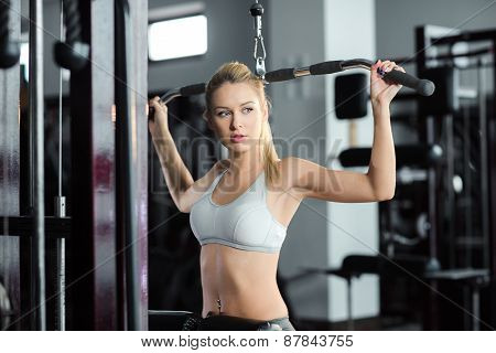 Girl doing exercises on her back in the gym