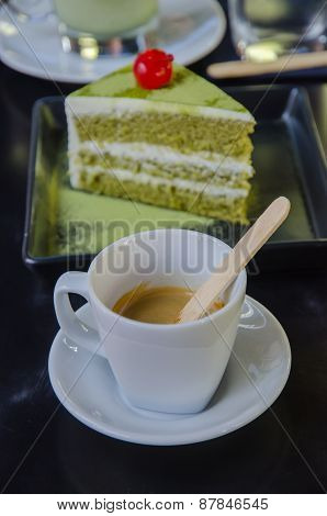 green tea cake with a cup of hot green tea latte