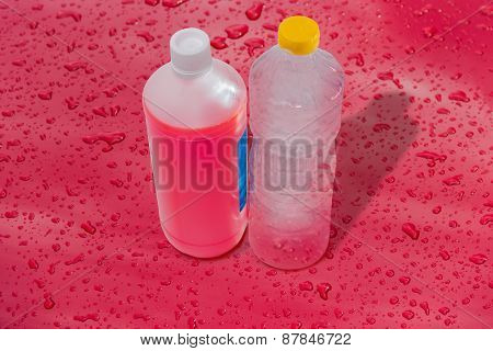 Bottles Of Antifreeze And Water