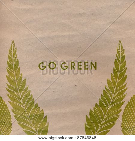 Go green text on craft paper and green traces of leaves