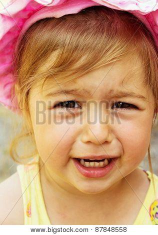 Close up Portrait of cute sad little girl