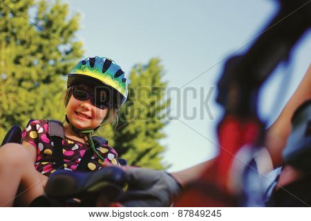 Little girl in the seat bicycle outdoor