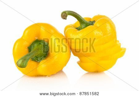 Closeup Slices Of Yellow Bell Peppers On White With Drops Of Water