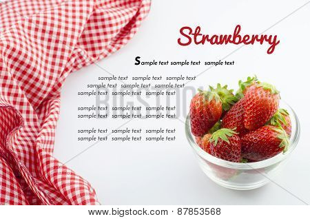 Strawberry In Bowl And Red Napkin Isolated On White With Sample Text