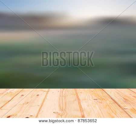 Blurry Meadow Landscape With Wooden Floor On Foreground