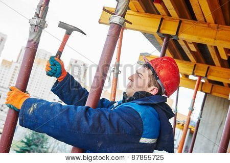 construction worker installing equipment for concrete work at building site