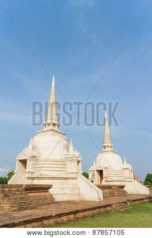 two white stupa under sunlight