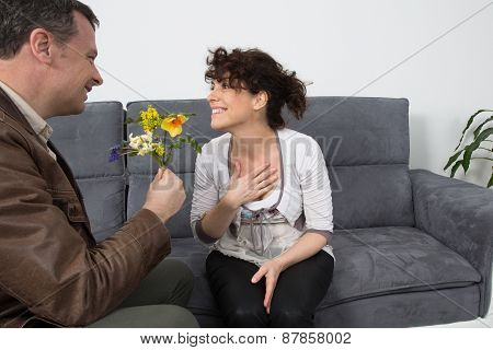 Couple Meeting On A Casual First Date Indoors On Sofa