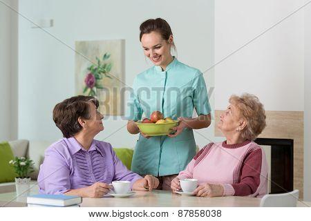 Nurse Serving Tea And Snacks