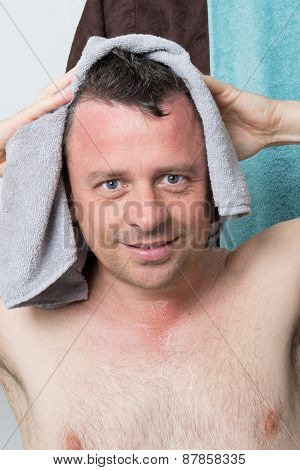 Attractive Man Drying His Body With A Towel