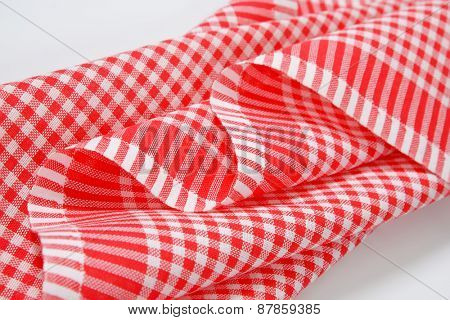 detail of red and white checkered dishtowel