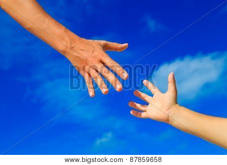 helping hand of mother and child on sky