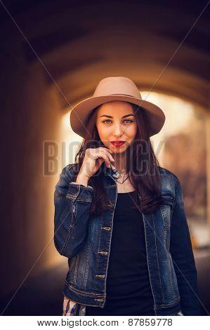 Portrait Of A Brunette Wearing A Hat