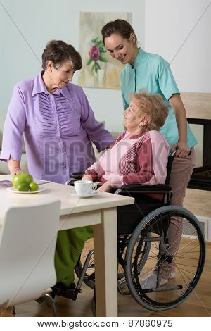 Woman On Wheelchair, Friend And Nurse