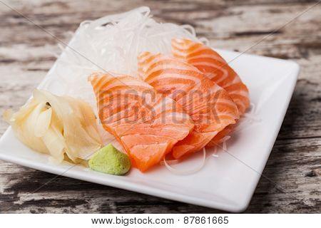 Salmon sashimi with withe plate