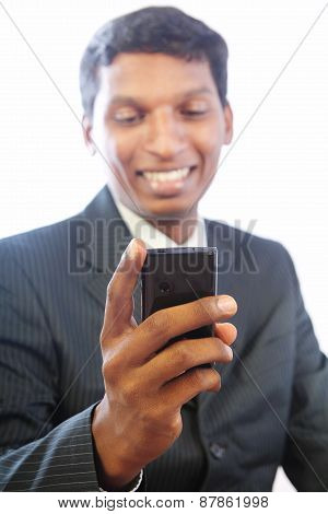 Indian Businessman Holding a Cell phone