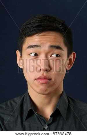 Young Asian man looking sideways