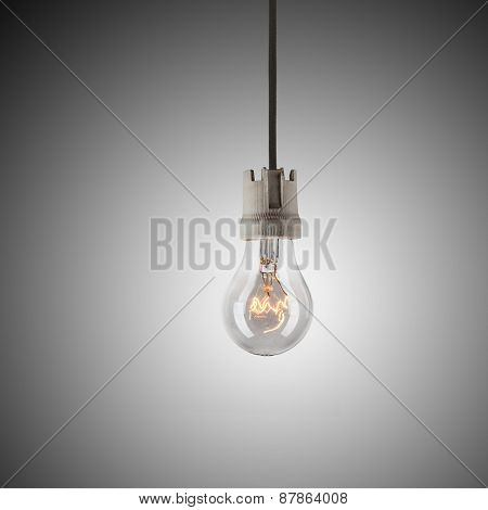 Light bulb hanging on wire