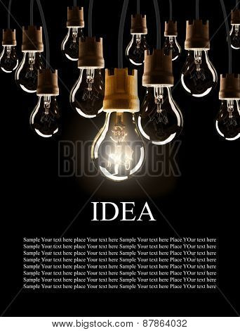 Light bulbs with single one shinning, isolated on black background
