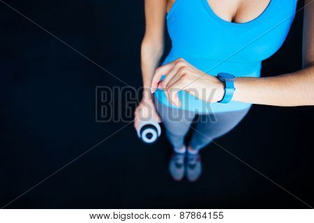 Woman with activity tracker and shaker