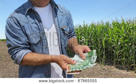 Agricultural Concept, Farmer, Money And Field