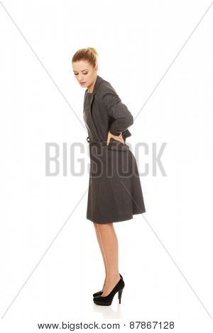 Businesswoman having huge back pain.