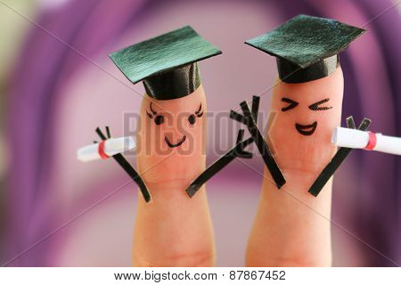Face painted on the fingers. students holding their diploma after graduation