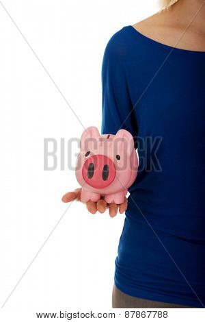 Young casual woman holding piggybank.