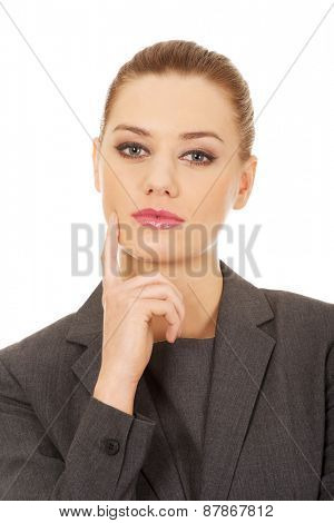 Beautiful caucasian thoughtful business woman.