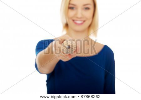 Happy woman pointing on you with pencil.