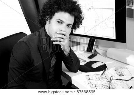 Handsome Modern Architect Thinking In Office