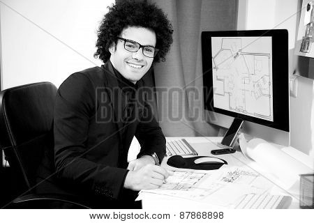 Smiling Young Cool Interior Designer In Office