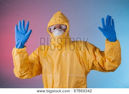 Scientist with protective yellow hazmat suit.