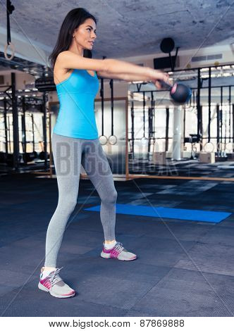 Full length portrait of a young woman attractive young working out at gym