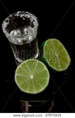 Tequila With Lime On Black Background