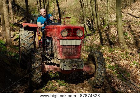 Lumberjack On His Logging Tractor